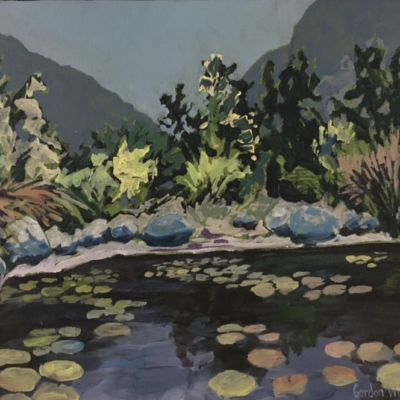 Scene from Henry Porter Gardens in Betty's Bay of lily pond, reeds, trees and mountains.  Colour palette of blue, green & purples.